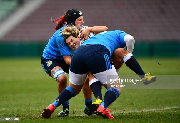 Vicky Fleetwood of England is tackled by Elisa Pillotti and Valentina Ruzza of Italy during the RBS Womens Six Nations match between England and...