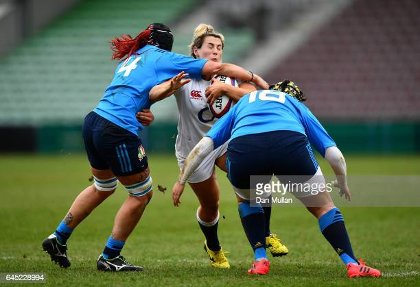 Vicky Fleetwood of England is tackled high by Elisa Pillotti and Valentina Ruzza of Italy during the RBS Womens Six Nations match between England and...