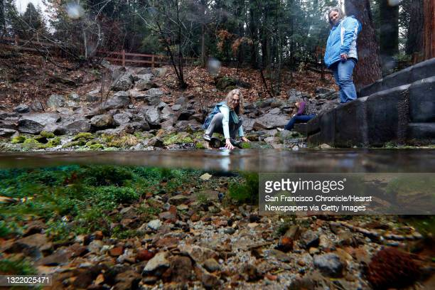 Vicky Gold, Kim Hermanson and Courtney Laverty, collect water at Spring Hill the headwaters of the Sacramento River, in Mt. Shasta City, Calif. On...