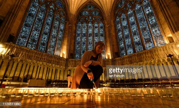 Vicky Harrison Assistant Director of Collections and Learning at York Minster helps to light six hundred candles in the form of the Star of David set...