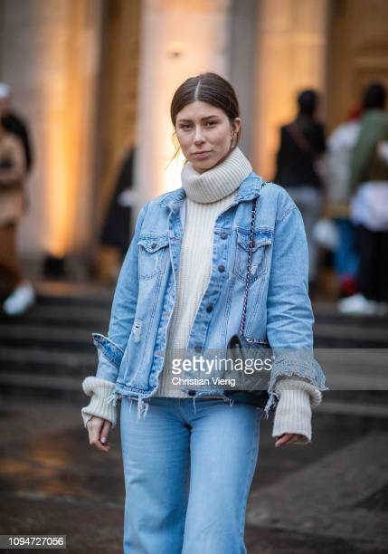 Vicky Heiler is seen wearing turtleneck denim jacket and flared denim jeans Chanel bag during the Berlin Fashion Week Autumn/Winter 2019 on January...