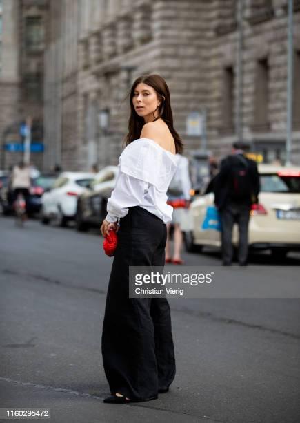 Vicky Heiler is seen wearing white off shoulder top black wide leg pants outside Nobi Talai during Berlin Fashion Week on July 04 2019 in Berlin...