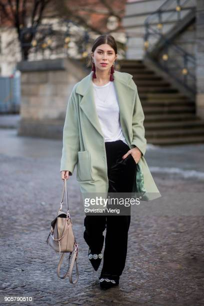 Vicky Heiler wearing mint Lala Berlin coat Chloe bag Marc Cain pants Mango top and earrings is seen outside Der Berliner Modesalon during the Berlin...