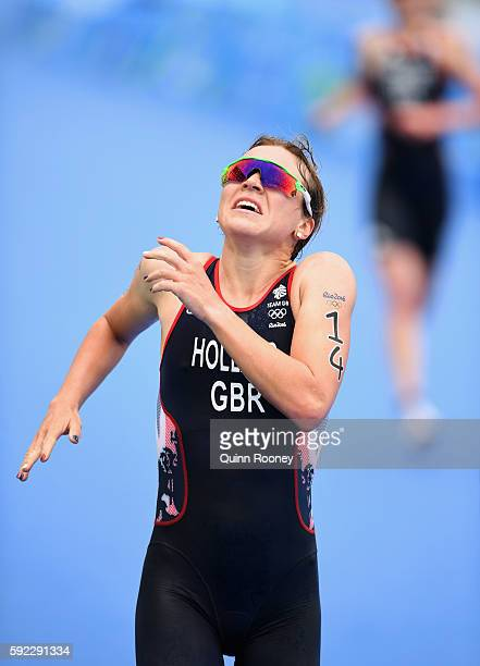 Vicky Holland of Great Britain celebrates as she approaches the line to win bronze during the Women's Triathlon on Day 15 of the Rio 2016 Olympic...