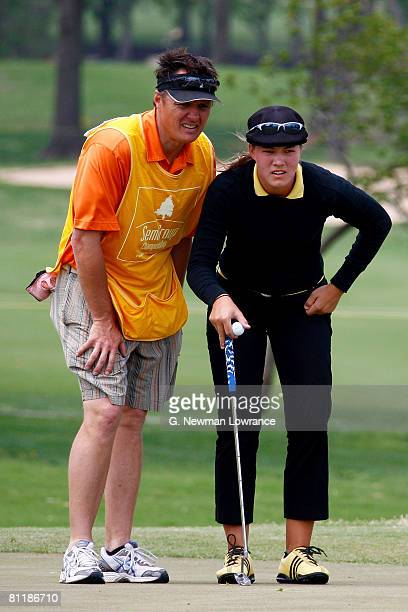 Vicky Hurst and her caddie evaluate the green during the first round of the SemGroup Championship presented by John Q Hammons on May 1 2008 at Cedar...