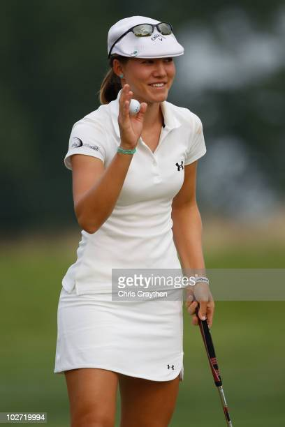 Vicky Hurst reacts after making a putt on the 16th hole during round one of the 2010 US Women's Open at Oakmont Country Club on July 8 2010 in...