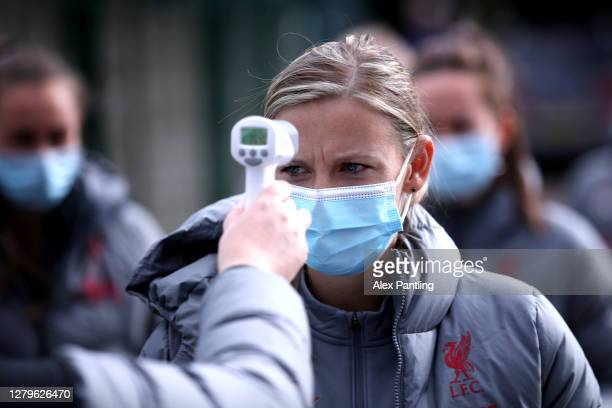 Vicky Jepson, Manager of Liverpool has her temperature checked prior to the Barclays FA Women's Championship match between Leicester City Women and...