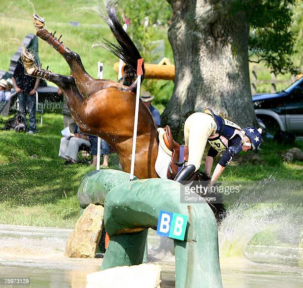 Vicky Laing falls from her horse Joli Figaro during the cross country phase of the British Open Championship at the British Festival of Eventing at...