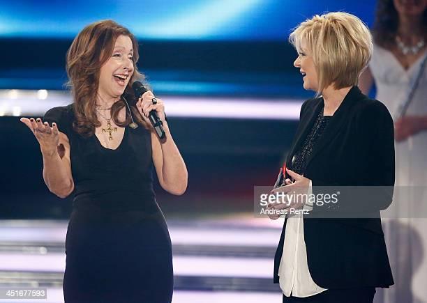 Vicky Leandros performs as TV host Carmen Nebel smiles during the   Willkommen bei Carmen Nebel.   9b1378f89e