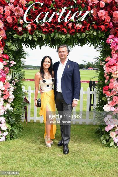 Vicky Lee and Laurent Feniou attend the Cartier Queen's Cup Polo at Guards Polo Club on June 17 2018 in Egham England