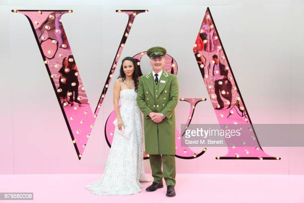 Vicky Lee poses with the Harrods Green Man at the Summer Party at the VA in partnership with Harrods at the Victoria and Albert Museum on June 20...
