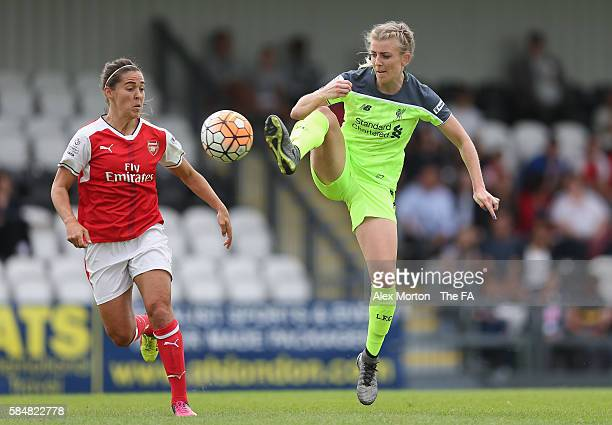 Vicky Losada of Arsenal and Kate Longhurst of Liverpool in action during the WSL match between Arsenal Ladies and Liverpool Ladies at Meadow Park on...