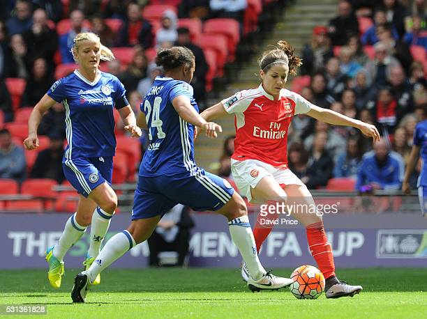 Vicky Losada of Arsenal Ladies takes on Drew Spence and Katie Chapman of Chelsea Ladies during the match between Arsenal Ladies and Chelsea Ladies at...