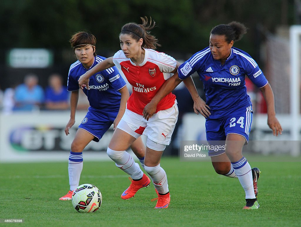 Vicky Losada of Arsenal takes on Rebecca Spence of Chelsea during the match between Arsenal Ladies and Chelsea Ladies at Meadow Park on August 23, 2015 in Borehamwood, England.