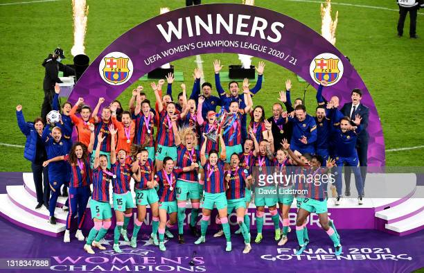 Vicky Losada of FC Barcelona lifts the UEFA Women's Champions League Trophy in celebration with team mates following the UEFA Women's Champions...