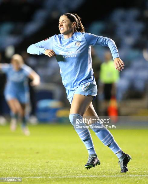 Vicky Losada of Manchester City celebrates after scoring their side's second goal as she appears to be injured during the Vitality Women's FA Cup...