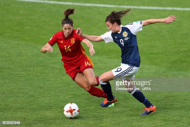 Vicky Losada of Spain and Caroline Weir of Scotland battle for possession during the Group D match between Scotland and Spain during the UEFA Women's...