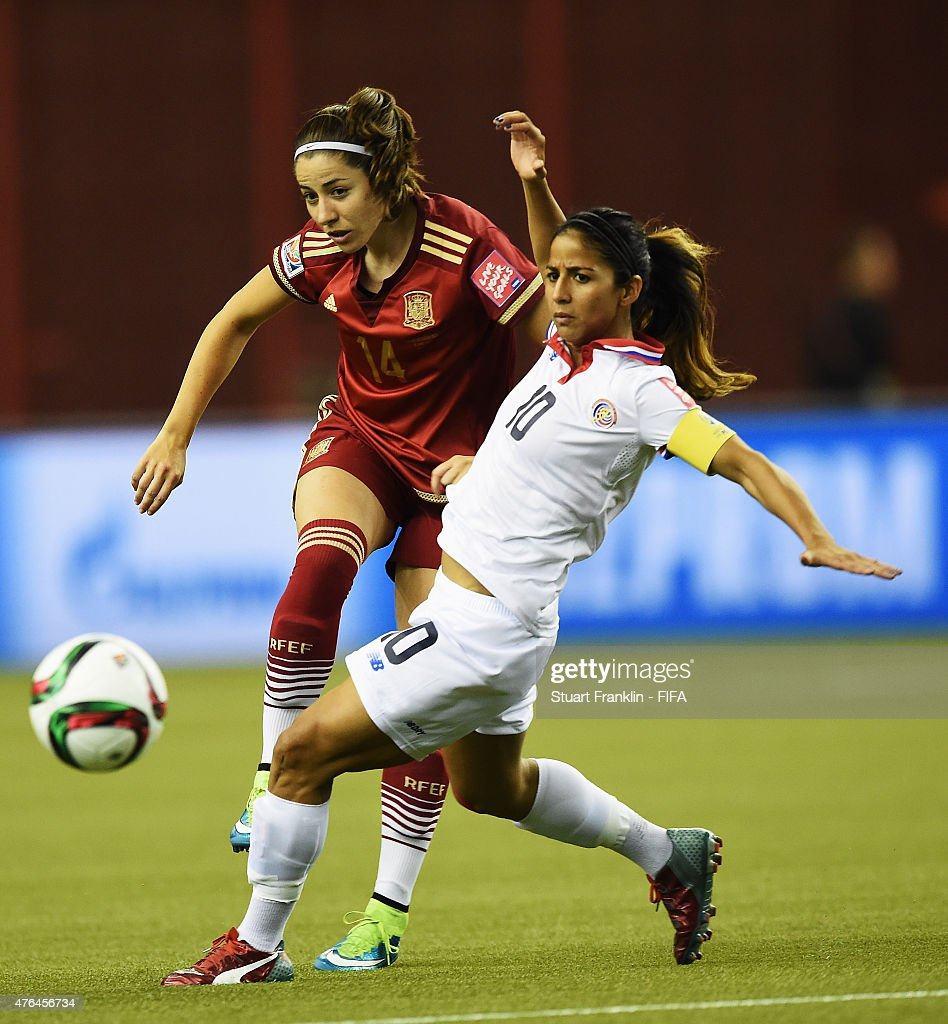 Vicky Losada of Spain is challenged by Shirley Cruz of Costa Rica during the FIFA Women's World Cup 2015 group E match between Spain and Costa Rica at Olympic Stadium on June 9, 2015 in Montreal, Canada.