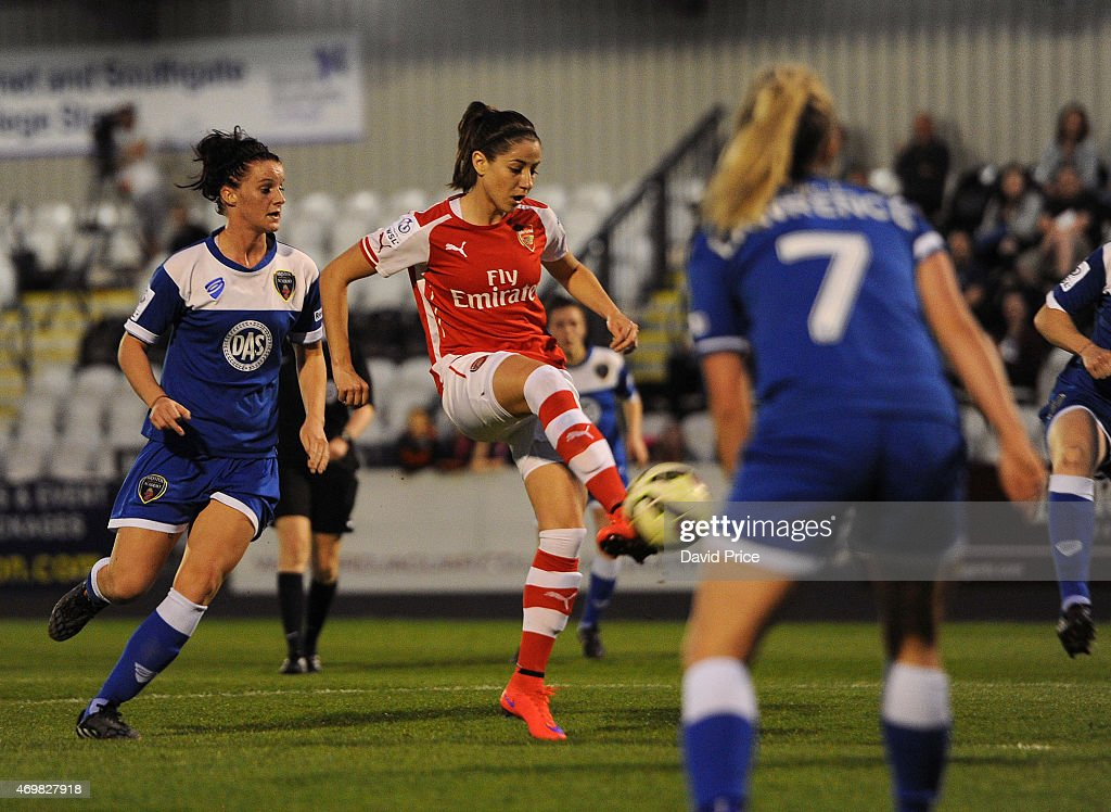 Vicky Losada scores Arsenal's 2nd goal under pressure from Jasmine Matthews of Bristol during the WSL match between Arsenal Ladies and Bristol Academy at Meadow Park on April 15, 2015 in Borehamwood, England.