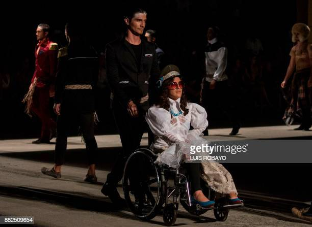 Vicky Monrroy models a creation by Colombian designer Guio Di Colombia during the Walkway Inclusion fashion show in Cali Colombia on November 29 2017...