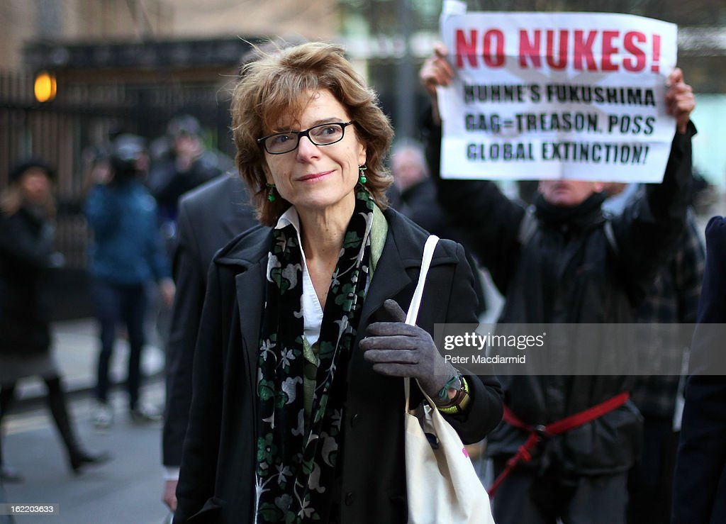 Vicky Pryce, ex-wife of Chris Huhne, leaves Southwark Crown Court followed by a an anti-nuclear protestor on February 20, 2013 in London, England. Former Cabinet member Chris Huhne has pleaded guilty to perverting the course of justice over claims his ex-wife took speeding points for him in 2003. Ms Pryce, 60, faces a re-trial after the jury failed to reach a verdict.