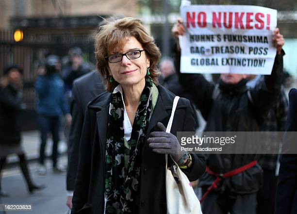 Vicky Pryce exwife of Chris Huhne leaves Southwark Crown Court followed by a an antinuclear protestor on February 20 2013 in London England Former...