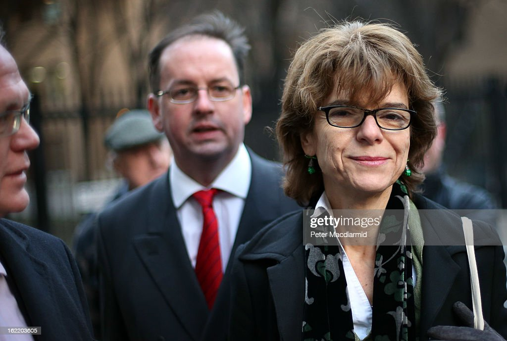 Vicky Pryce (R), ex-wife of Chris Huhne, walks from Southwark Crown Court with her legal team on February 20, 2013 in London, England. Former Cabinet member Chris Huhne has pleaded guilty to perverting the course of justice over claims his ex-wife took speeding points for him in 2003. Ms Pryce, 60, faces a re-trial after the jury failed to reach a verdict.