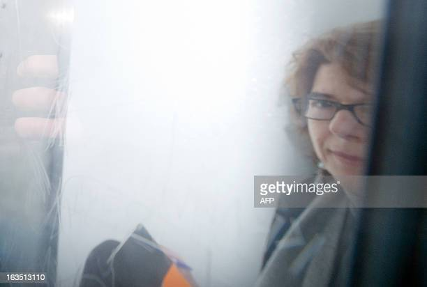 Vicky Pryce the exwife of former British Energy Minister Chris Huhne is driven in a prison van from Southwark Crown Court in London on March 11 after...