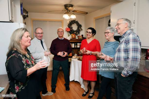 TORONTO ON DECEMBER 2 Vicky Sanderson and her husband John Baumann plaid shirt friends in their North York home for a holiday party December 2 2017...