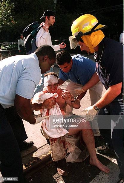 A victim being attended to by EMS workers and other bystanders in the area of the World Trade Center attack