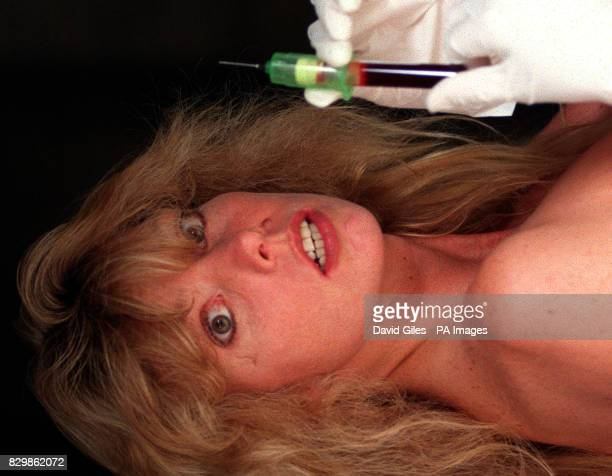 HIV victim Gretchen Adams with a syringe full of HIV blood part of the touring exhibition 'Don't Be Scared' by Tony Kaye The exhibition which is at...