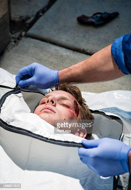 victim in a body bag - body bag stock photos and pictures