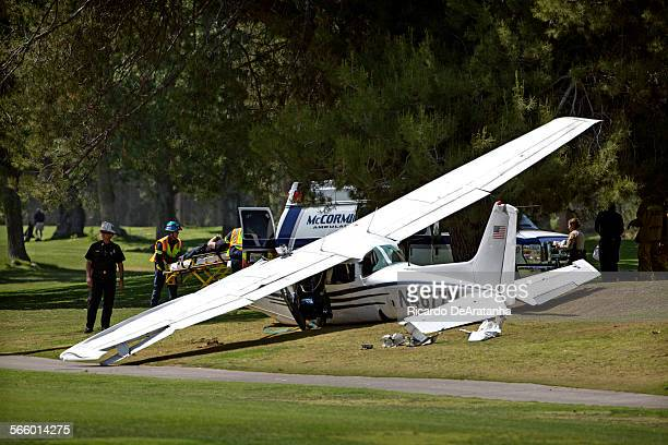 Victim is wheeled into an ambulance, at Westlake Village Golf Course, where a single-engine plane made crashed Monday, April 29, 2013. Three people...