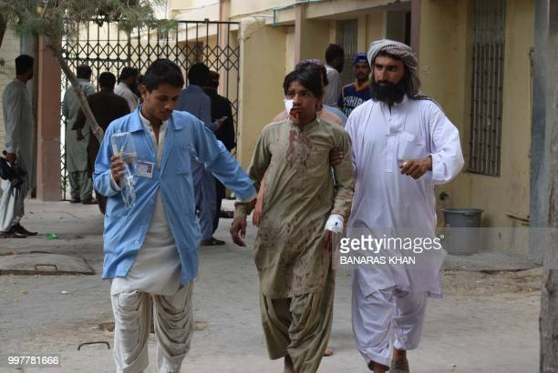 A victim of a bomb blast is brought to a hospital in Quetta on July 13 2018 following an attack at an election rally A bomb killed at least 25 people...