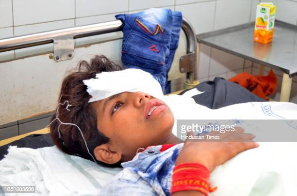 A victim of a train accident at Joda Phatak being treated at Civil Hospital on October 20 2018 in Amritsar India A train plowed into a crowd that had...