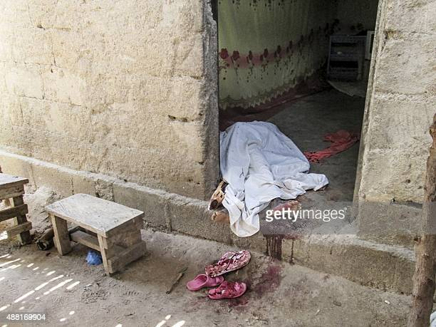 A victim of a twin suicide attack lies on the ground in the doorway of her home in the extreme north village of Kolofata on September 13 2015 Two...
