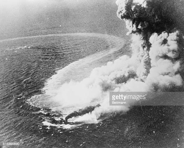 Victim of a U.S. Navy torpedo dropped by a Grumman Avenger, this Jap destroyer, veiled in a gigantic cloud of smoke steam and foam, goes through its...