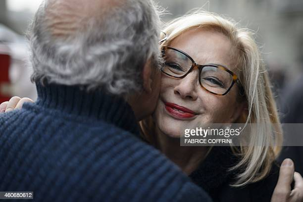 Victim of abuse Swiss Ursula Biondi is greeted by relative during the handover of a petition as part of 'Repair' a public initiative calling for...