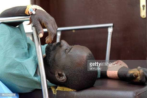 A victim of an attack by armed men in the Bayotte forest lies on a hospital gurney in the regional capital Ziguinchor southern Senegal on January 7...