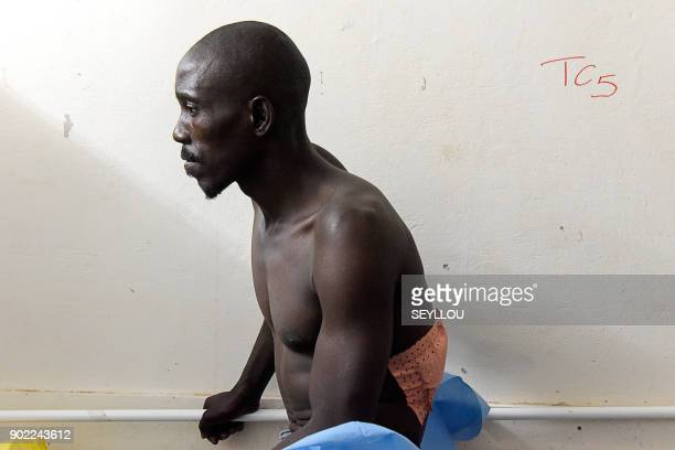 A victim of an attack by armed men in the Bayotte forest waits after being treated in the regional capital Ziguinchor southern Senegal on January 7...