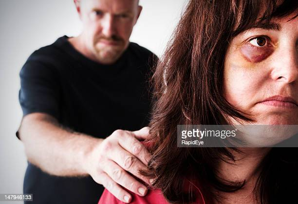 victim of domestic violence, this despairing woman cannot escape - hand on shoulder stock photos and pictures