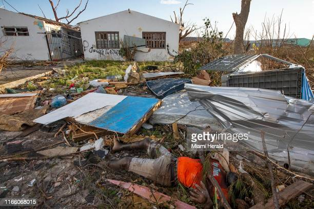 A victim of Hurricane Dorian lies in the destruction in an area called The Mud at Marsh Harbour in Great Abaco Island Bahamas on Thursday September 5...