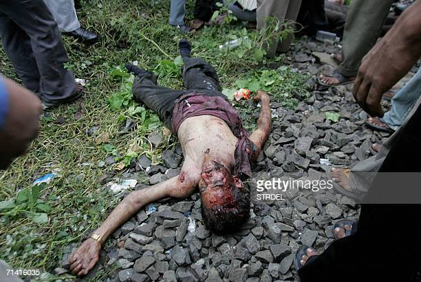 A victim of one of the blast affected local trains lies alongside the railway tracks at Mahim railway station in Mumbai 11 July 2006 Seven explosions...