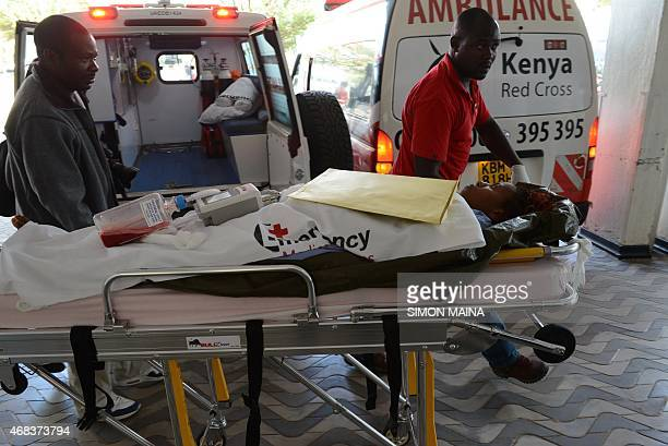 Victim of the attack on a Kenyan university, -Garissa University College- is wheeled into the Kenyatta hospital, on April 2, 2015 in Nairobi....