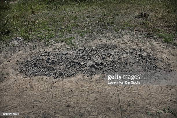 A victim of the district of Leodiet hastily buried on the spot Photograph Laurent Van der Stockt/Edit by Getty Images