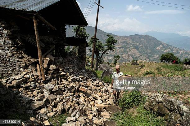 A victim of the earthquake walks back to his house after receiving food and goods at an aid distribution point on May 1 2015 in Bhotechaur Nepal A...