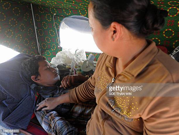 A victim of the recent earthquake rests at a camp outside Thabeik Kyin township Mandalay a division in central Myanmar on November 12 2012 Rescuers...