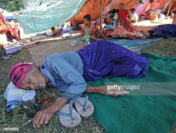 A victim of the recent earthquake rests at a temperory relief camp in Thabeik Kyin township Mandalay a division in central Myanmar on November 12...