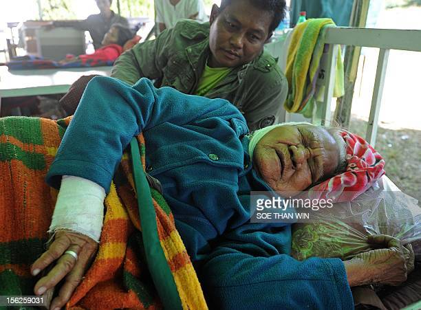 A victim of the recent earthquake rests on a bed at KyiTaukPauk hospital in Thabeik Kyin township Mandalay a division in central Myanmar on November...