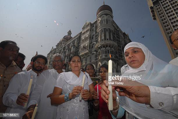 26/11 victim Sabira Khan pays homage to those who died in the November 2008 terror attacks at a memorial outside the Taj Mahal Palace hotel on the...